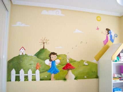 A mural of two book characters painted on the wall of a children's library