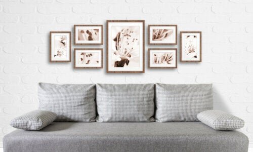 Paintings over a sofa.