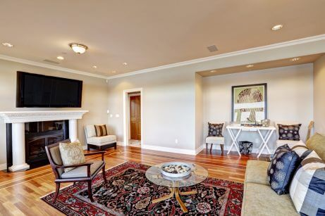 A Persian rug next used to delimit the seating area of a living room