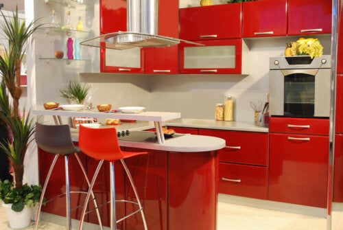 A red kitchen with white floors.