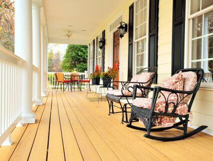 Rustic wooden porch with two rocking armchairs