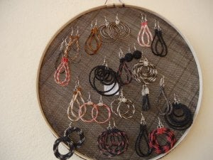 You can use old sieves to hang earrings.
