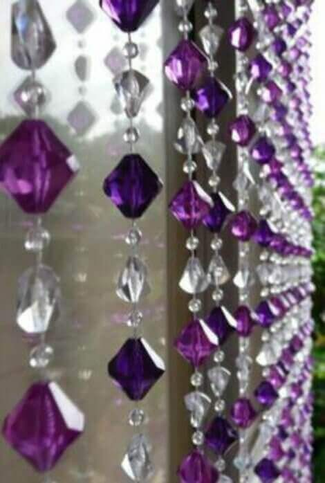 Sound curtain made with clear and purple crystals