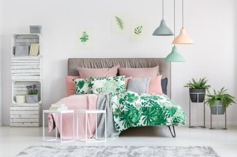 A cozy bedroom using a white, gray and pastel color pallete