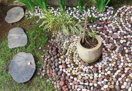 A DIY stone flower bed is a great and easy outdoor decoration project