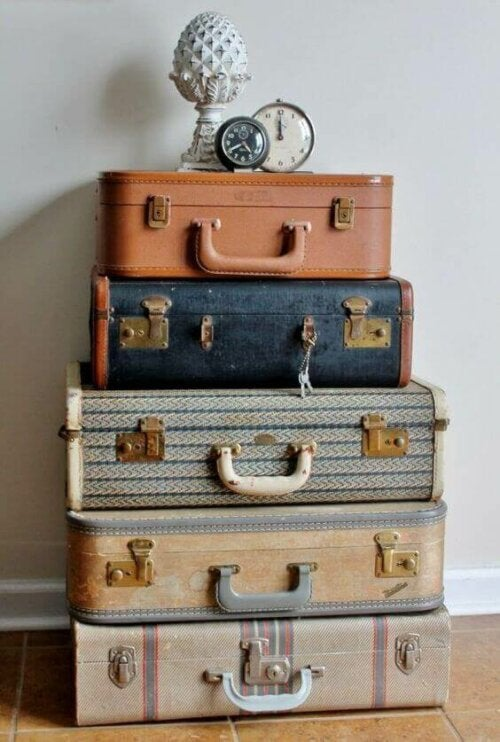 In-style storage: five suitcases piled on top of each other.