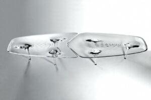 The Liquid Glacial table by Zaha Hadid is created with Plexiglas.
