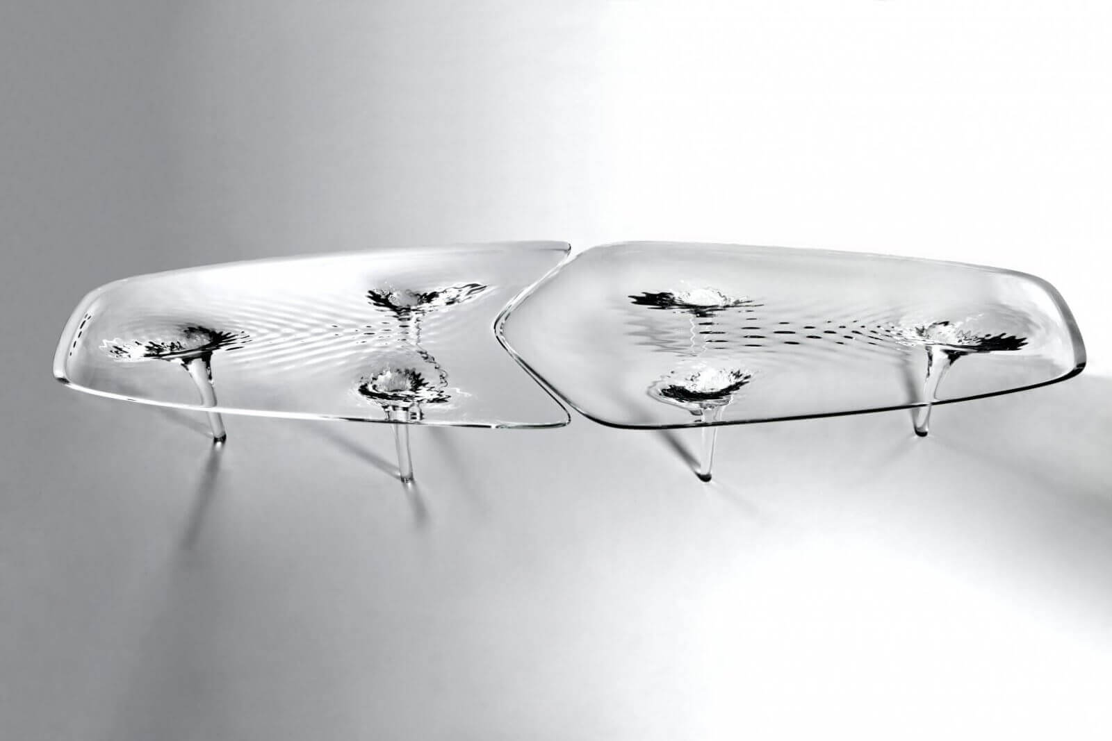 The Liquid Glacial table by Zaha Hadid is created with Plexiglas.