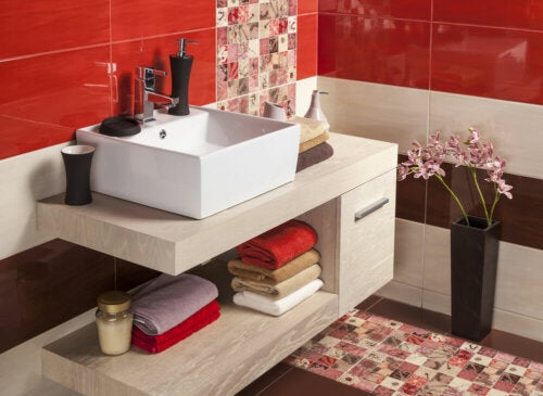 A bright red, tiled bathroom.