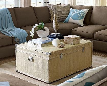 A big trunk used as a table in a living room.