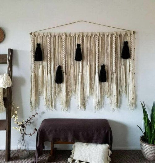 A black and gold decorative element on the wall.