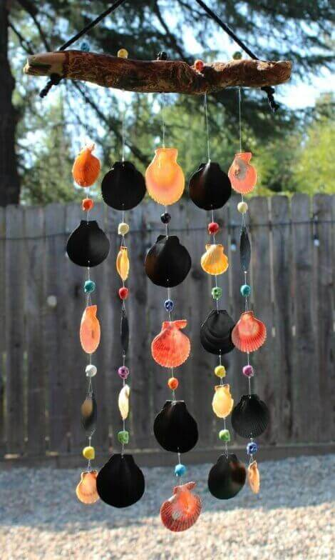 A wind chime made by hand with sea shells and other decorative elements