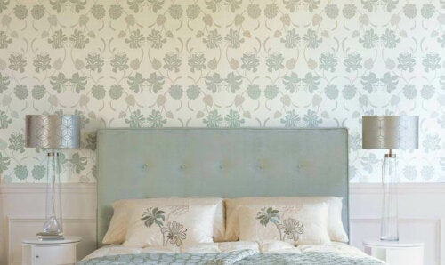 A bedroom with floral wallpaper.