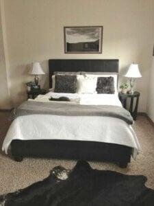 Beige, gray and black bedroom decor.