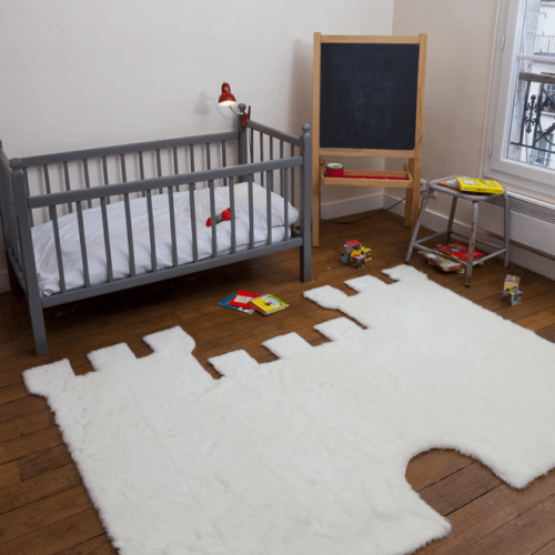 A castle rug in a child's room.