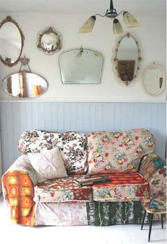 A sofa with lots of different patterns.