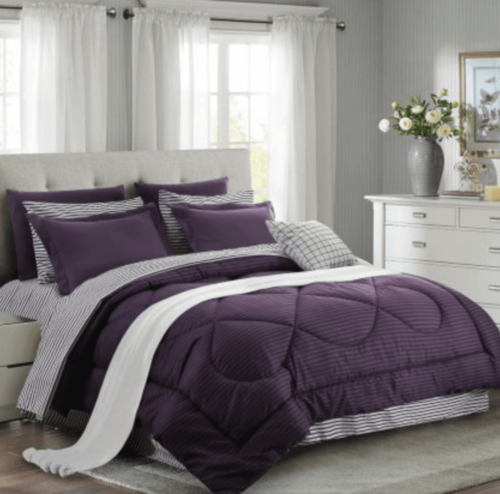 A bedroom with eggplant purple details.