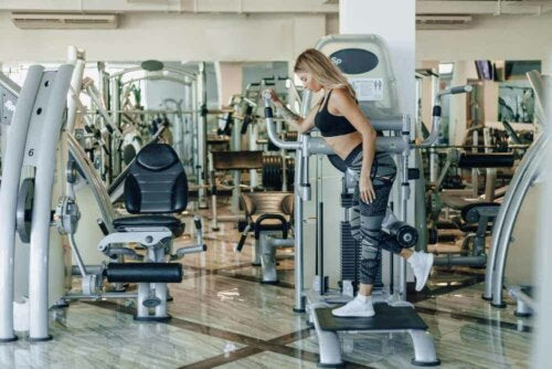 A woman using an exercise machine.