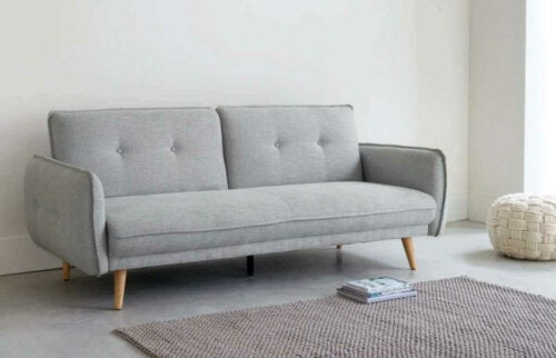 A gray Maison du Monde sofa.