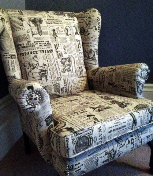 An armchair with a newspaper pattern.