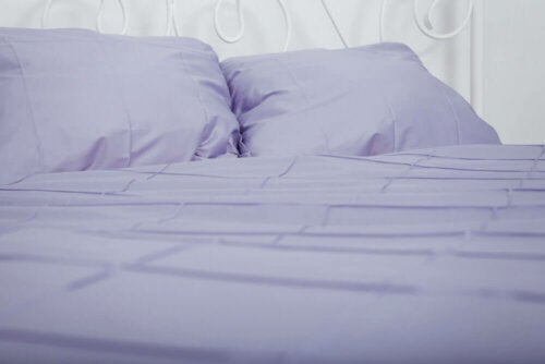 Purple bed sheets.