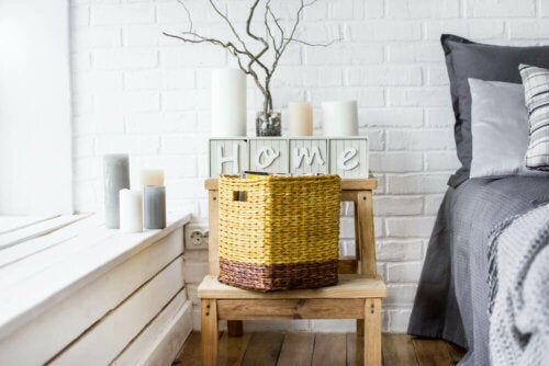 A bedroom with a wicker container on the nightstand beside it.
