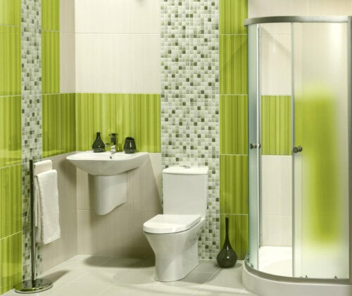 A bathroom with some apple green highlights.