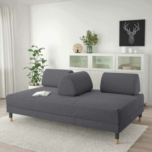 A gray sofa with a detachable back.