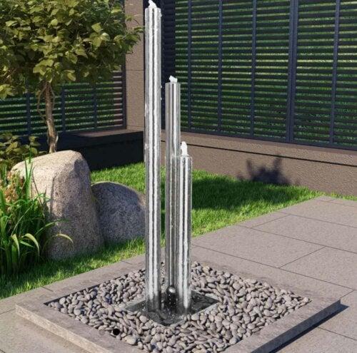 A tall minimalist fountain in a patio.