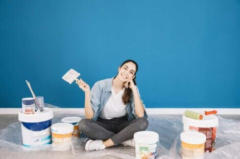 Woman with cans of paint ready to decorate