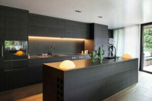 Black kitchen counters and cabinets.