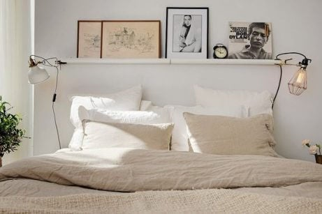 Low bed with white linens for small bedrooms