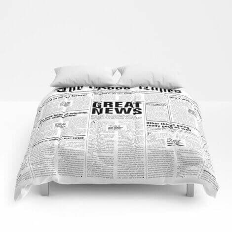 A bedspread the looks like newspaper