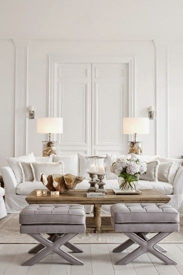 A white room with gray footstools