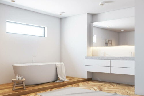 A bathroom with a wooden floor.
