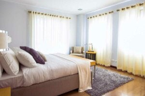 A bedroom with curtains for better sleep.