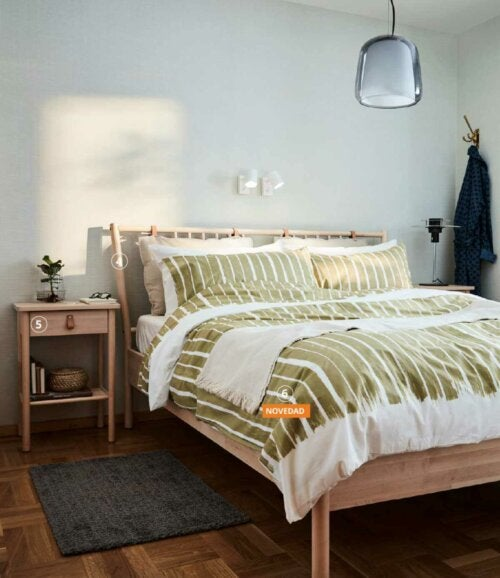 A bedroom with furniture from the IKEA catalogue.