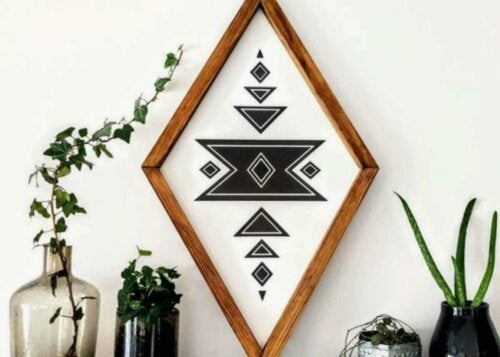 A geometric patterned frame with some plants.