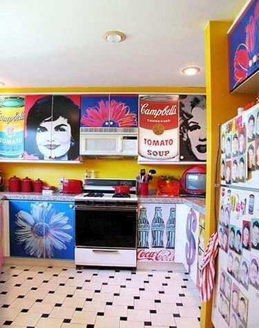 A kitchen with a lot of pop art.