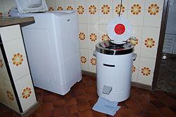 A mini washing machine in a kitchen.