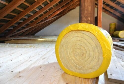A roll of insulation in an attic.
