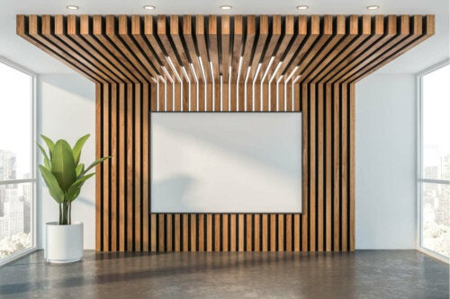 A wall with some wood paneling.