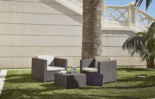 Some furniture on a lawn.
