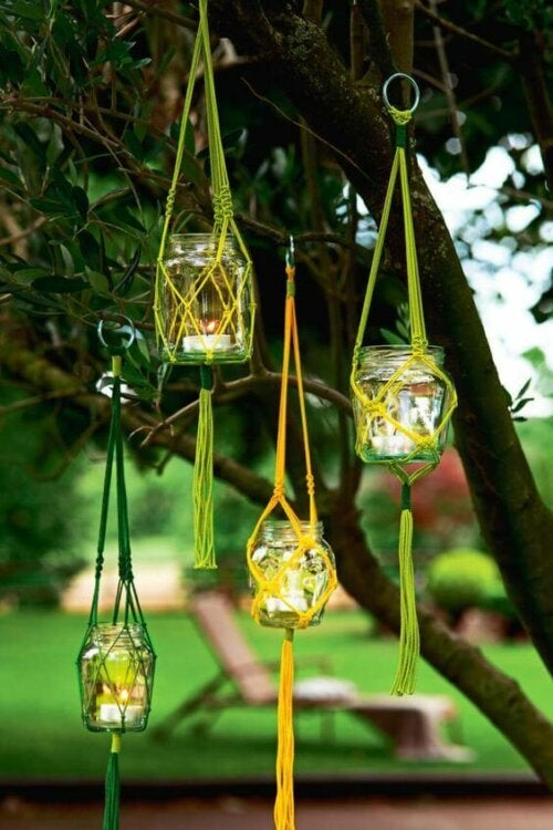 Some handmade lanterns hanging on a tree.