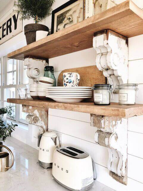 Some wooden shelves with plates.