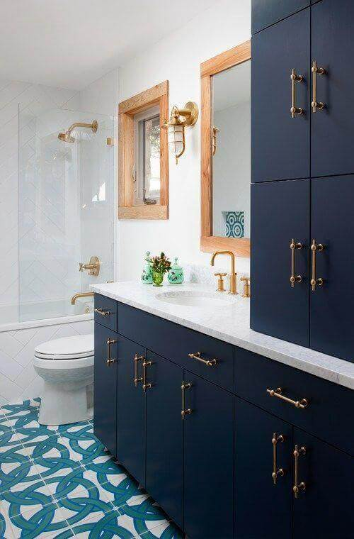 A bathroom with the color indigo.