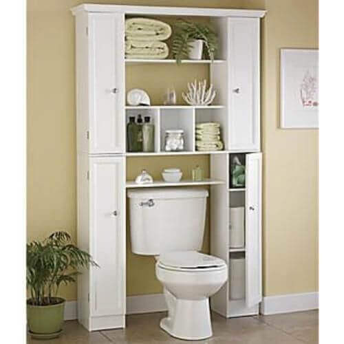 A cabinet over a toilet.
