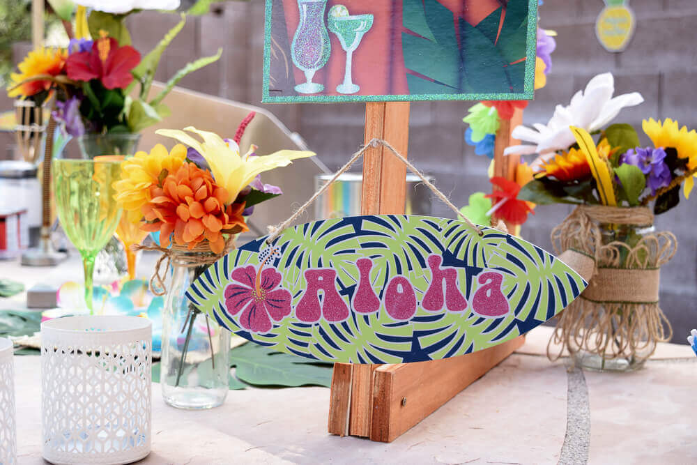 Set the table a certain way to achieve a Hawaiian theme.