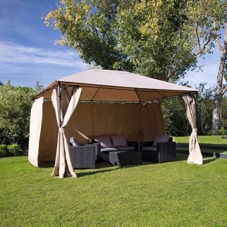 A tent set up in a yard for family parties