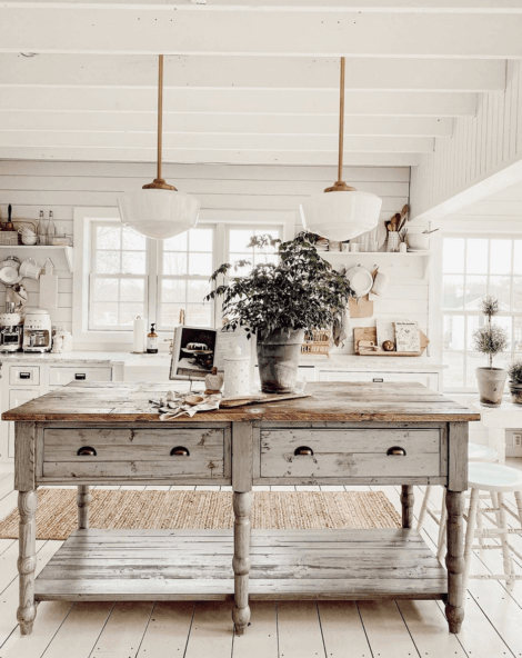 A country kitchen with a shappy chic piece of furniture, often found in appealing kitchens